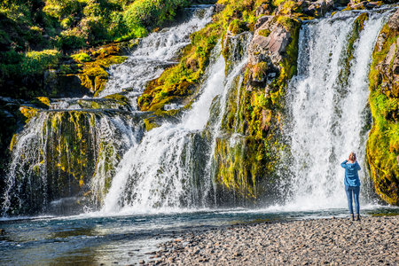 Wonderful waterfall Kirkjufellsfoss in Iceland, Autumn colors, close up Stock Photo