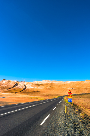 Isolated road and Icelandic colorful landscape at Iceland, late Summer time, almost Autumn