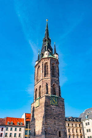 View of Red Tower, Roter Turm, in Halle (Saale), Germany, blue sky, sunset Фото со стока