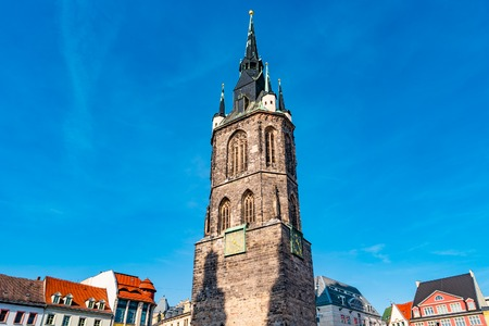 View of Red Tower, Roter Turm, in Halle (Saale), Germany, blue sky, sunset Stock Photo