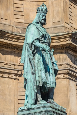 Statue of King Charles IV at Charles (Karluv most) Bridge Tower arched gateway in Prague, Czech Republic.