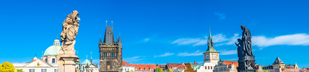 Bird view of Old Town Charles (Karluv most) Bridge Tower arched gateway in Prague, Czech Republic, blue sky