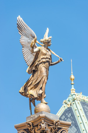 Statue of beautiful angel with wings in front of the Rudolfinum concert hall in Prague, Czech Republic, portrait, details, blue sky Stock Photo
