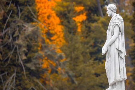 Lonely statue of Roman Era philosopher and thinker at golden Autumn, Potsdam, Germany Foto de archivo