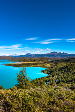 View of Torres del Paine National Park, its forests, lagoon, glaciers and camping site, Patagonia, Chile Banque d'images - 119148720