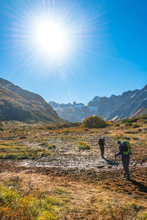 Hikers at Beautiful landscape of lenga forest, mountains at Tierra del Fuego National Park, Patagonia, autumn Banque d'images - 119148824