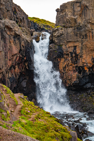 Wonderful and high waterfall Fardagafoss near Egilsstadir on Eastern Iceland, summer time Stock Photo