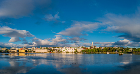 Panoramic view of Reykjavik downtown with lake on Iceland during sunset