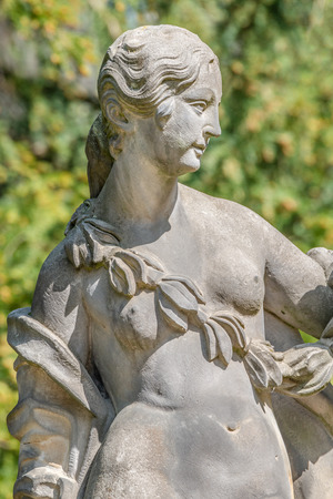 Ancient statue covered with moss and lichen of a sensual renaissance era woman in Potsdam, Germany, details, closeup 版權商用圖片