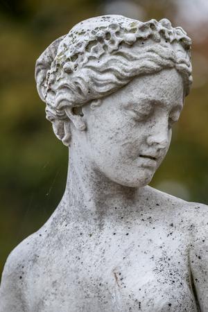 Statue of sensual naked Greek renaissance era woman with flowers, Potsdam, Germany