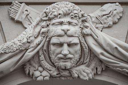 Ancient Roman warrior in lion skin with hunting arrows as gatekeeper, Potsdam, Germany Standard-Bild