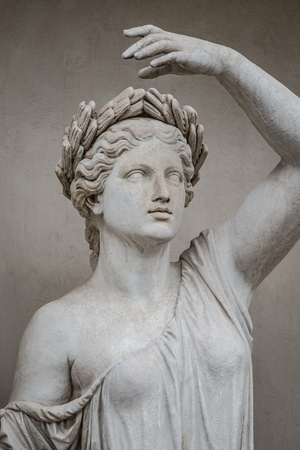 Statue of sensual Roman renaissance era woman in circlet of bay leaves, Potsdam, Germany Stock Photo