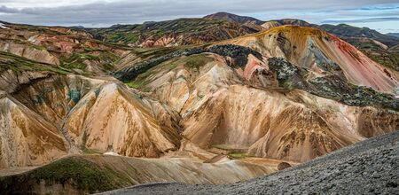 Panoramic view of colorful rhyolite volcanic mountains Landmannalaugar as pure wilderness in Iceland, summer time