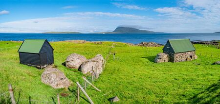 Panoramic view of Faroe islands seashore with traditional farm houses, summer time Stock Photo