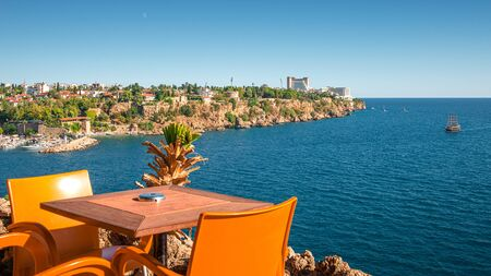 Panoramic view from a outdoor cafe at old harbor and downtown Marina in Antalya, Turkey, sunny day, blue sky