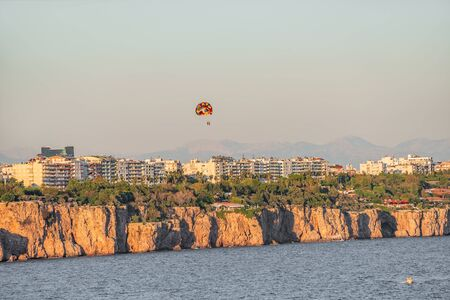 Panoramic bird view of Antalya and Mediterranean seacoast and beach with a paraglider, Antalya, Turkey, summer time