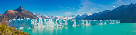 Panoramic view over gigantic Perito Moreno glacier in Patagonia with blue sky and turquoise water glacial lagoon, South America, Argentina, at sunny day