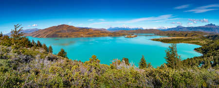 Panoramic view over mountain turquoise lagoon in Torres del Paine National Park at sunny day and blue sky, Patagonia, Chile