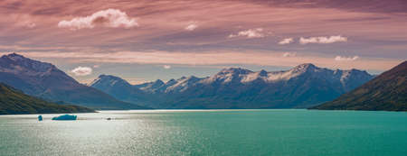 Panoramic view over mountain turquoise lagoon near famous Perito Moreno glacier and with austral forests at golden Autumn and reddish sunset in Patagonia, South America, Argentina Stok Fotoğraf