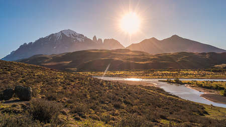 Panoramic view over beautiful Torres del Paine National Park, its major mountain group, during sunset, Patagonia, Chile, direct light