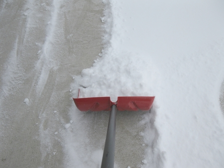 Shoveling snow on the driveway