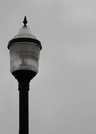 Lamp post on overcast day with copy space on right, vertical