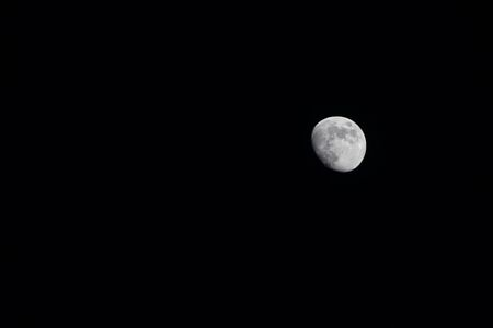 Moon in black night sky