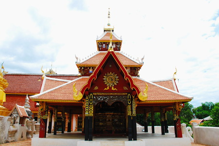 horse carriage and  temple Phrathat Lampang Luang in Lampang, Thailand photo