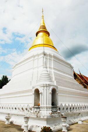 cartage: horse carriage and  temple Phrathat Lampang Luang in Lampang, Thailand