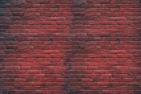 The surface of the brick from the background wall.