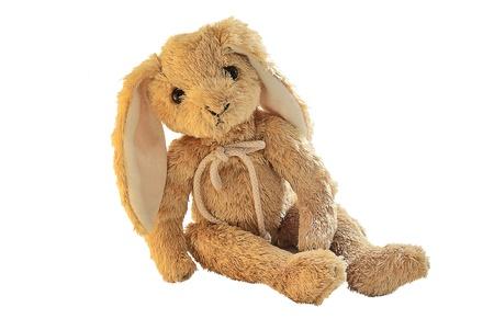 juguetes antiguos: Conejito de peluche aislado en blanco. Foto de archivo