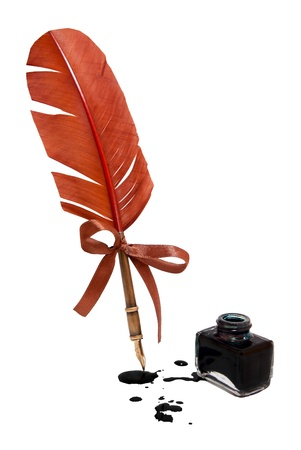 Feather quill and inkwell isolated on white.