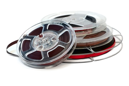Vintage reels of audio tape isolated on white background