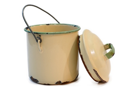 Vintage old enamel milk can bucket with lid Stock Photo