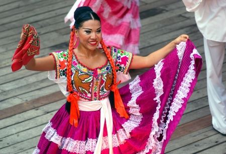 Dancer wearing ethnic costume. Stage of Xcaret park in Riviera Maya, Cancun, Mexico. June 2012 Stock Photo - 18112067