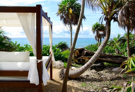 Beautiful white bed on the beach, near wild nature. Place for relaxing and privacy. photo