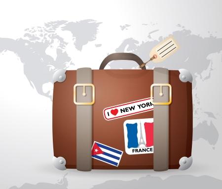 Valise vintage avec des autocollants, carte du monde en arrière-plan