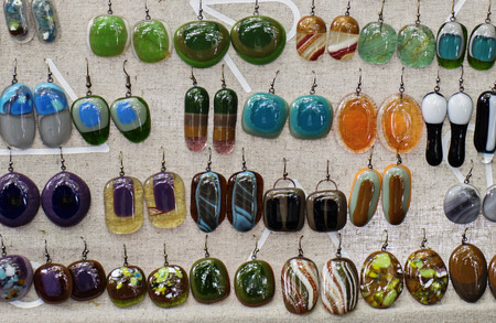 fused: Display with artisan jewelry, fused glass dangling earrings, wide array of styles and colors Stock Photo
