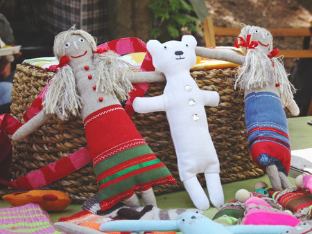 rags: colorful sewed handmade dolls on a fair, Europe, Latvia