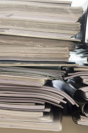 order chaos: Stacks of folders with documents, close up view