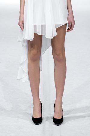 defile: model on runway - focus on female legs