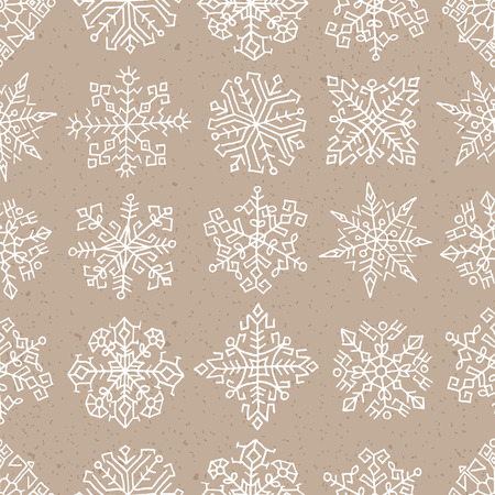 Seamless pattern with hand drawn snowflakes. Ethnic design, White objects on craft paper background