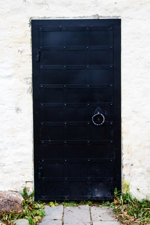 Close-up of the antique and medieval style door left opened
