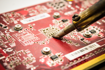 Microcircuit repair with a soldering iron