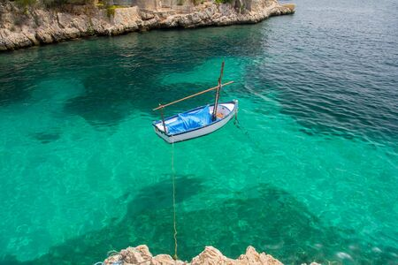 clear water: top view of small boat on azure sea
