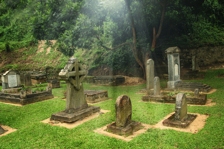 christian halloween: old graveyard with light Stock Photo