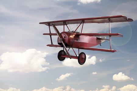 retro plane flying on sky Standard-Bild