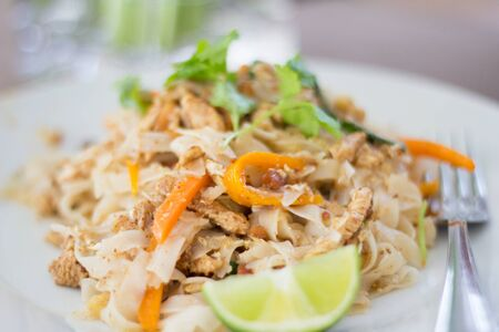fried noodles pad thai closeup on plate Stock Photo