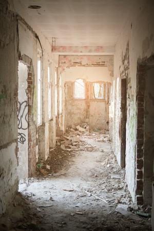 destructed: hallway in creepy ruined house
