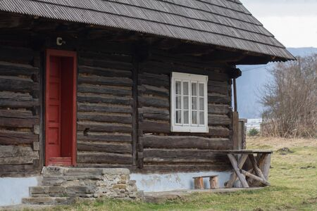 Entrance to a rustic timber cabin with stone steps